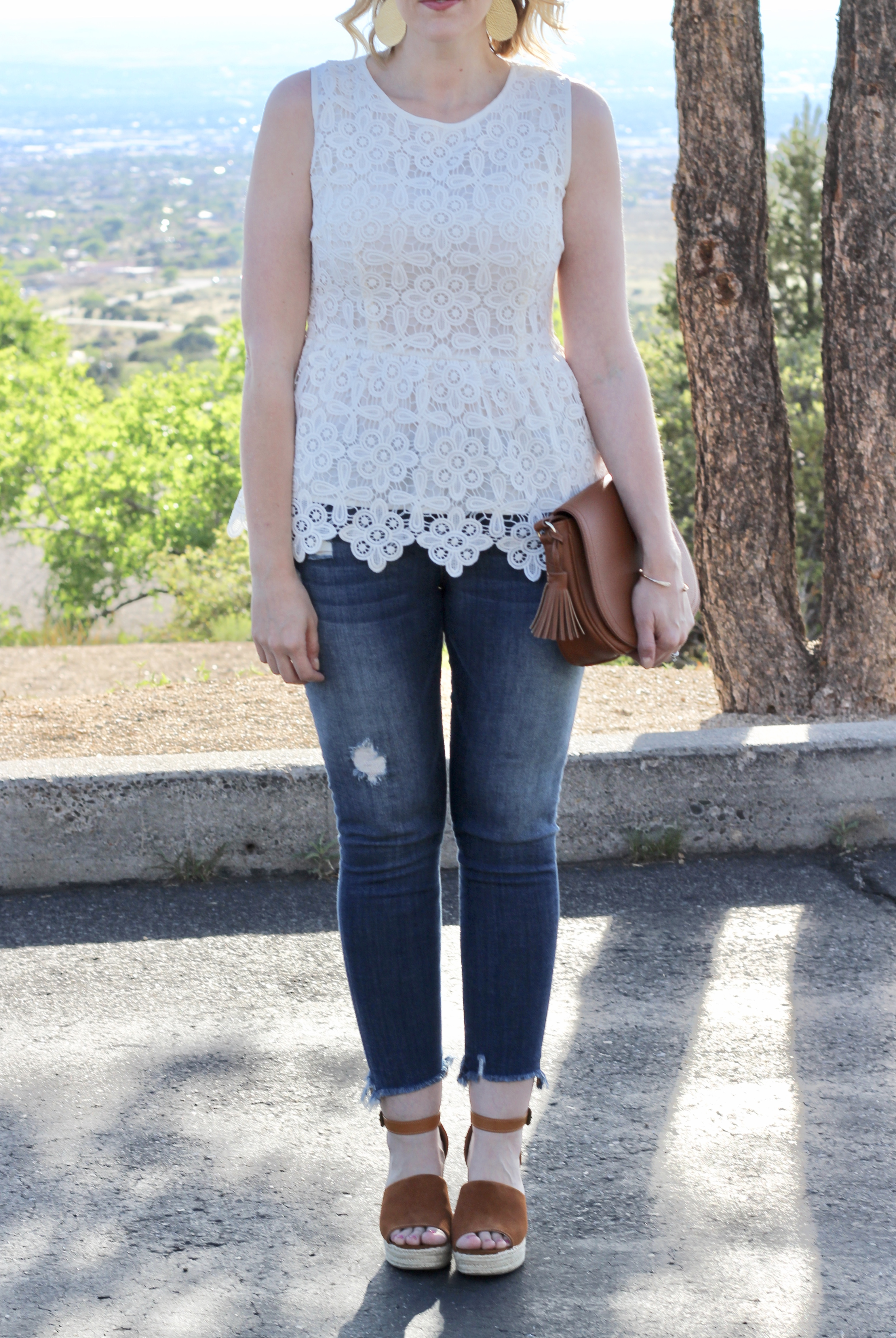 lace peplum top and distressed jeans