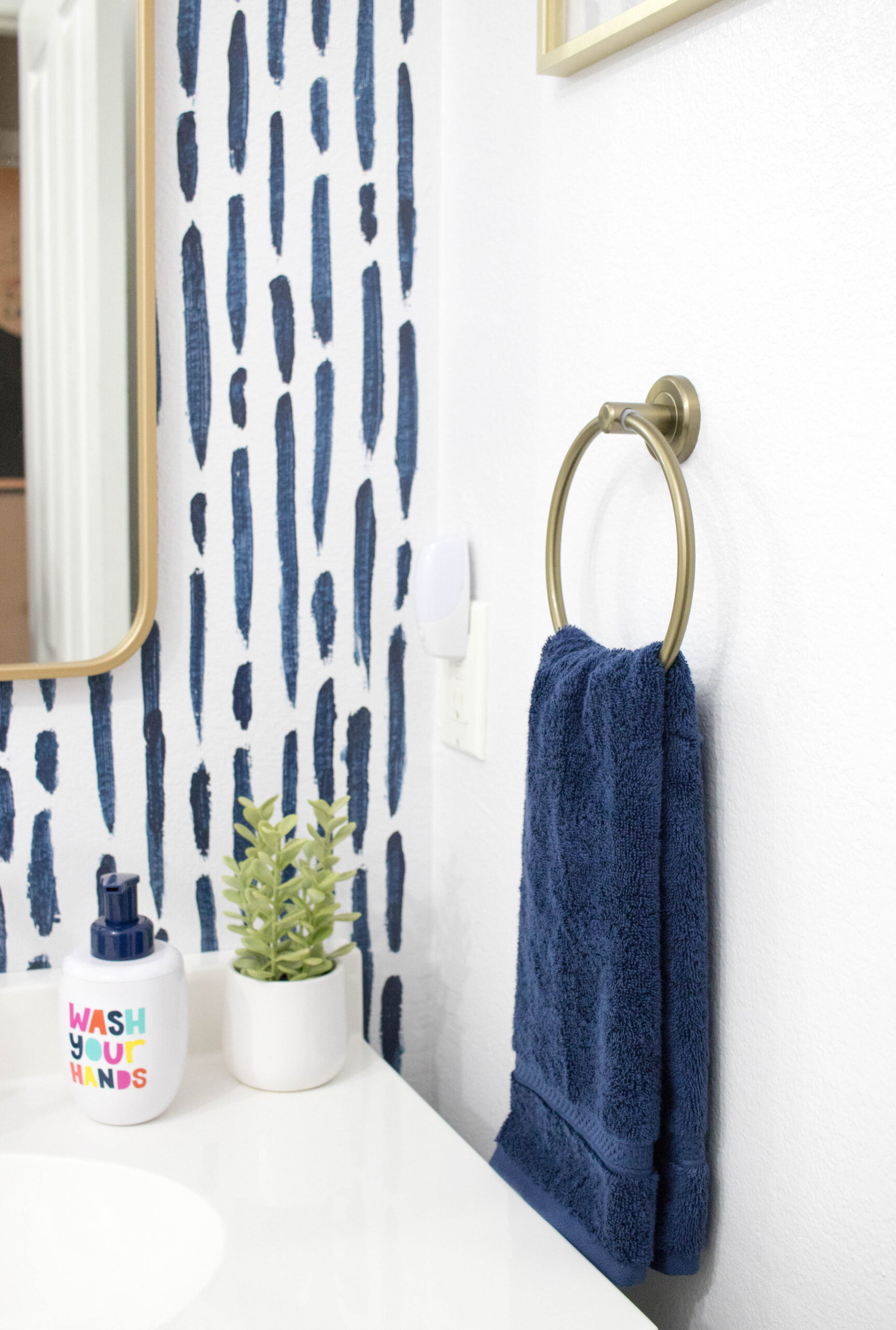 gold and navy bathroom decor #bathroomdecor #bathroomrefresh #diyaccentwall